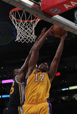 LOS ANGELES, CA - JANUARY 25:  Andrew Bynum #17 of the Los Angeles Lakers drives to the basket while being defended by Al Jefferson #25 of the Utah Jazz in the second half at Staples Center on January 25, 2011 in Los Angeles, California. The Lakers defeat