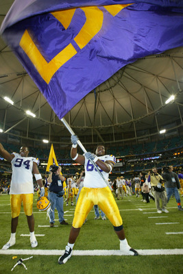 ATLANTA, GA - DECEMBER 6:  Offensive guard Terrell McGill #68 of the LSU Tigers waives the team flag after the game against the Georgia Bulldogs inthe SEC Championship Game on December 6, 2003 at the Georgia Dome in Atlanta, Georgia. LSU defeated Georgia