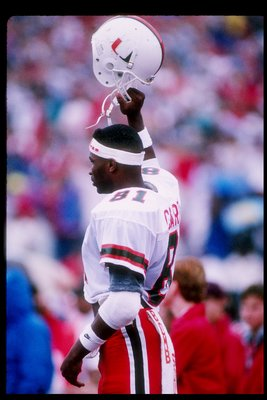 9 Sep 1989:  Wide receiver Wesley Carroll of the Miami Hurricanes holds up his helmet during a game against the Wisconsin Badgers at Camp Randall Stadium in Madison, Wisconsin.  Miami won the game 51-3. Mandatory Credit: Jonathan Daniel  /Allsport