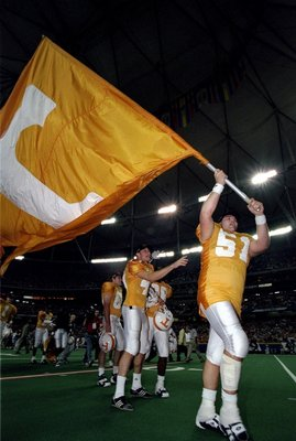 5 Dec 1998: Kevin Gregory #51 of the Tennessse Volunteers marches with a flag during the SEC Championships against the Mississippi State Bulldogs at the Georgia Dome in Athens, Georgia. Tennessee defeated Mississippi St. 24-14.
