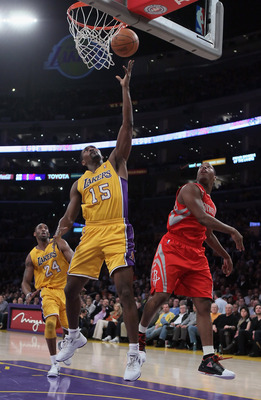 LOS ANGELES, CA - FEBRUARY 01:  Ron Artest #15 of the Los Angeles Lakers drives to the basket past Kyle Lowry #7 of the Houston Rockets in the first half at Staples Center on February 1, 2011 in Los Angeles, California. NOTE TO USER: User expressly acknow
