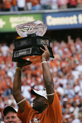 HOUSTON - DECEMBER 3:  Quarterback Vince Young #10 of the Texas Longhorns holds up the trophy following the Dr. Pepper Big 12 Championship against the Colorado Buffaloes at Reliant Stadium on December 3, 2005  in Houston, Texas. The Longhorns defeated the