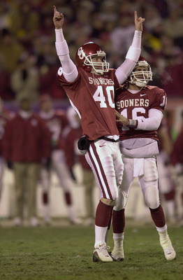 2 Dec 2000: Tim Duncan #40 of the Oklahoma Sooners celebrates his field goal in the fourth quarter with teammate Patrick Fletcher #16 during the Big 12 Championship against the Kansas State Wildcats at Arrowhead Stadium in Kansas City, Missouri. Oklahoma