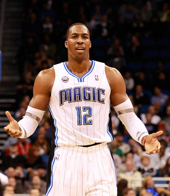 ORLANDO, FL - FEBRUARY 08:  Dwight Howard #12 of the Orlando Magic reacts to a foul during the game against the Los Angeles Clippers at Amway Arena on February 8, 2011 in Orlando, Florida.  NOTE TO USER: User expressly acknowledges and agrees that, by dow