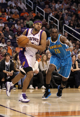 PHOENIX, AZ - JANUARY 30:  Jared Dudley #3 of the Phoenix Suns drives the ball past Quincy Pondexter #20 of the New Orleans Hornets during the NBA game at US Airways Center on January 30, 2011 in Phoenix, Arizona.  The Suns defeated the Hornets 104-102. N