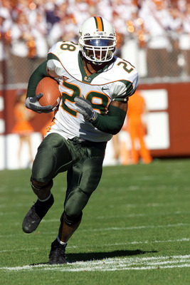 1 Dec 2001:  Clinton Portis #28 of Miami runs with the ball during the first half of the Miami Hurricanes v Virginia Tech Hokies game at Lane Stadium in Blacksburg, Virgina. DIGITAL IMAGE. Mandatory Credit: Craig Jones/ALLSPORT