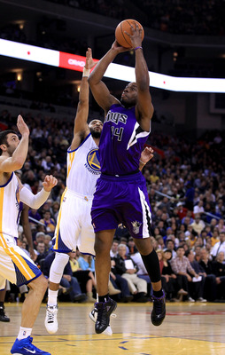 OAKLAND, CA - JANUARY 21:  Carl Landry #24 of the Sacramento Kings goes up for a shot against the Golden State Warriors at Oracle Arena on January 21, 2011 in Oakland, California. NOTE TO USER: User expressly acknowledges and agrees that, by downloading a
