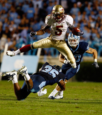 CHAPEL HILL, NC - OCTOBER 22:  Greg Reid #5 of the Florida State Seminoles leaps over North Carolina Tar Heels defenders Kennedy Tinsley #36 and Hunter Furr, #40 at Kenan Stadium on October 22, 2009 in Chapel Hill, North Carolina.  (Photo by Scott Hallera