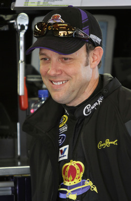 DAYTONA BEACH, FL - FEBRUARY 11:  Matt Kenseth, driver of the #17 Crown Royal Ford, stands in the garage during practice for the NASCAR Budweiser Shootout at Daytona International Speedway on February 11, 2011 in Daytona Beach, Florida.  (Photo by Jerry M