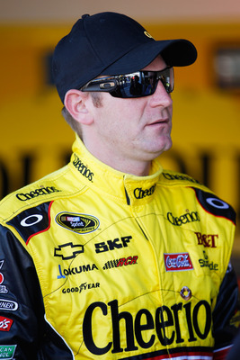 DAYTONA BEACH, FL - FEBRUARY 12:  Clint Bowyer, driver of the #33 Cheerios Chevrolet, stands in the garage area during practice for the NASCAR Sprint Cup Series Daytona 500 at Daytona International Speedway on February 12, 2011 in Daytona Beach, Florida.