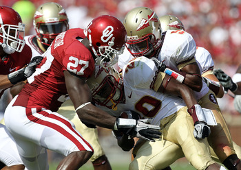 NORMAN, OK - SEPTEMBER 11:  Lamarcus Joyner #20 of the Florida State Seminoles returns a kick against Sam Proctor #27 of the Oklahoma Sooners at Gaylord Family Oklahoma Memorial Stadium on September 11, 2010 in Norman, Oklahoma.  (Photo by Ronald Martinez