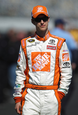 DAYTONA BEACH, FL - FEBRUARY 13:  Joey Logano, driver of the #20 Home Depot Toyota, walks during qualifying for the NASCAR Sprint Cup Series Daytona 500 at Daytona International Speedway on February 13, 2011 in Daytona Beach, Florida.  (Photo by Nick Laha