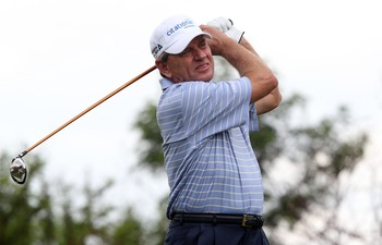 SUN CITY, SOUTH AFRICA - DECEMBER 02: Nick Price of Zimbabwe in action during day 1 of the 2010 Nedbank Golf Challenge at the Gary Player Country Club Course on December 2, 2010 in Sun City, South Africa.  (Photo by Luke Walker/Gallo Images/Getty Images)