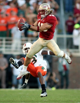 TALLAHASSEE, FL - OCTOBER 20:  Defensive back Anthony Houllis #46 of the Florida State Seminoles intercepts a pass in front of receiver Sam Shields #83 of the University of Miami Hurricanes in the second quarter at Bobby Bowden Field at Doak Campbell Stad
