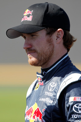 DAYTONA BEACH, FL - FEBRUARY 13:  Brian Vickers, driver of the #83 Red Bull Toyota, looks on during qualifying for the NASCAR Sprint Cup Series Daytona 500 at Daytona International Speedway on February 13, 2011 in Daytona Beach, Florida.  (Photo by Matthe