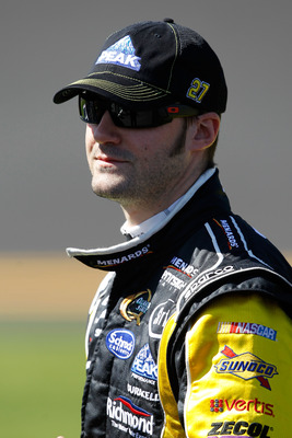 DAYTONA BEACH, FL - FEBRUARY 13:  Paul Menard, driver of the #27 Menards Chevrolet, looks on during qualifying for the NASCAR Sprint Cup Series Daytona 500 at Daytona International Speedway on February 13, 2011 in Daytona Beach, Florida.  (Photo by Matthe