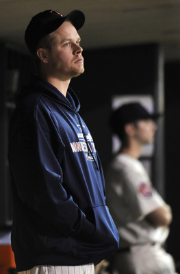 MINNEAPOLIS, MN - OCTOBER 7: Justin Morneau #33 of the Minnesota Twins in the dugout during game two of the ALDS game against the New York Yankees on October 7, 2010 at Target Field in Minneapolis, Minnesota. (Photo by Hannah Foslien /Getty Images)