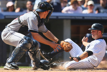 NEW YORK - MAY 30:  Brett Gardner #11 of the New York Yankees slides in ahead of the tag by Lou Marson #30 of the Cleveland Indians on Derek Jeter's (not shown RBI single in the seventh-inning) on May 30, 2010 in the Bronx borough of New York City.  (Phot