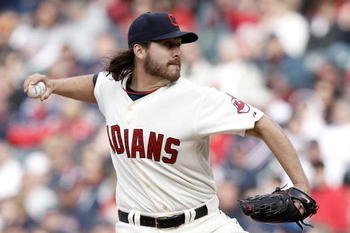 CLEVELAND, OH- APRIL 12: Chris Perez #54 of the Cleveland Indians pitches against the Texas Rangers during the Opening Day game on April 12, 2010 at Progressive Field in Cleveland, Ohio.  (Photo by Jared Wickerham/Getty Images)