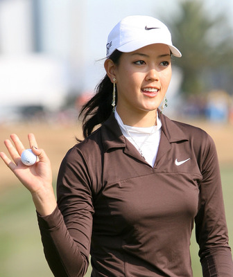KOCHI, JAPAN - NOVEMBER 24:  Michelle Wie holds up the ball on the first hole during the second round of the Casio World Open at Kuroshio Country Club on November 24, 2005 in Kochi, Japan.  (Photo by Koichi Kamoshida/Getty Images)