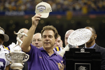 NEW ORLEANS - JANUARY 4:  Head coach Nick Saban of the Loiusiana State Tigers stands next to the Bowl Championship Series Trophy after his team defeated the Oklahoma Sooners in the Nokia Sugar Bowl National Championship on January 4, 2004 at the Louisiana