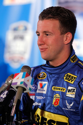 DAYTONA BEACH, FL - FEBRUARY 10:  AJ Allmendinger, driver of the #43 Best Buy Ford, speaks to members of the media during the 2011 NASCAR Media Day at Daytona International Speedway on February 10, 2011 in Daytona Beach, Florida.  (Photo by Todd Warshaw/G