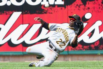 ST. LOUIS - AUGUST 1: Andrew McCutchen of the St. Louis Cardinals fields a fly ball against the Pittsburgh Pirates at Busch Stadium on August 1, 2010 in St. Louis, Missouri.  The Cardinals beat the Pirates 9-1.  (Photo by Dilip Vishwanat/Getty Images)