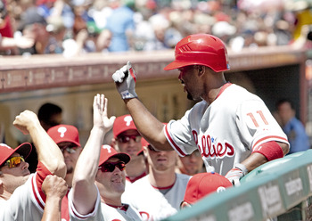 HOUSTON - APRIL 11:  Jimmy Rollins #11 of the Philadelphia Phillies receives high fives after a first inning home run against the Houston Astros at Minute Maid Park on April 11, 2010 in Houston, Texas.  (Photo by Bob Levey/Getty Images)