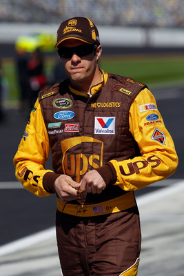 DAYTONA BEACH, FL - FEBRUARY 13:  David Ragan, driver of the #6 UPS Ford, walks on pit road during qualifying for the NASCAR Sprint Cup Series Daytona 500 at Daytona International Speedway on February 13, 2011 in Daytona Beach, Florida.  (Photo by Tom Pen