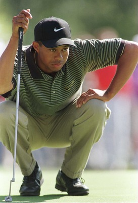 25 Oct 1996: Tiger Woods lines up a putt on the third hole during the second round of the 1996 PGA Tour Championship at Southern Hills Country Club in Tulsa, Oklahoma. Woods shot an 8 over par 78 and is at 8 over for the tournament.