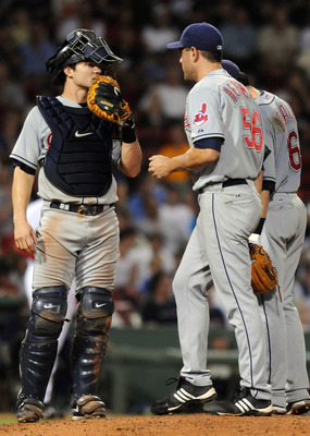BOSTON, MA - AUGUST 5: Lou Marson #30 of the Cleveland Indians talks with pitcher Frank Herrmann #56 and shortstop Jason Donald #16 during the eight inning against the Boston Red Sox August 5, 2010 at Fenway Park in Boston, Massachusetts. (Photo by Darren