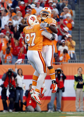 TAMPA, FL - DECEMBER 05:  Running back LeGarrette Blount #27 and receiver Mike Williams #19 of the Tampa Bay Buccaneers celebrate Blount's touchdown against the Atlanta Falcons during the game at Raymond James Stadium on December 5, 2010 in Tampa, Florida