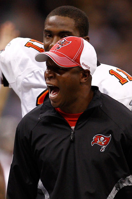 NEW ORLEANS, LA - JANUARY 02:  Head coach Raheem Morris of the Tampa Bay Buccaneers celebrates after a touchdown during the game against the New Orleans Saintsat the Louisiana Superdome on January 2, 2011 in New Orleans, Louisiana.  (Photo by Chris Grayth