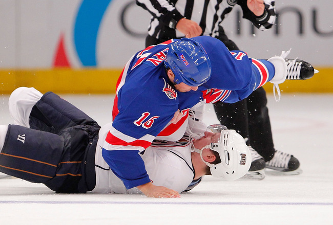 NEW YORK - NOVEMBER 14:  Ladislav Smid #5 of the Edmonton Oilers is on the bottom in a fight with Sean Avery #16 of the New York Rangers in the third period of a hockey game at Madison Square Garden on November 14, 2010 in New York City.  (Photo by Paul B
