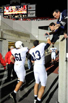 COLUMBUS, OH - OCTOBER 25: Stefen Wisniewski #61 and Andrew Dailey #13 of the Penn State Nittany Lions get congratulations from fans as they head to the locker room after defeating the Ohio State Buckeyes 13-6 on October 25, 2008 at Ohio Stadium in Columb