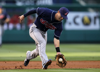 ANAHEIM, CA - SEPTEMBER 06:  Third baseman Jayson Nix #12 of the Cleveland Indians fields a ground ball against the Los Angeles Angels of Anaheim on September 6, 2010 at Angel Stadium in Anaheim, California.  (Photo by Stephen Dunn/Getty Images)