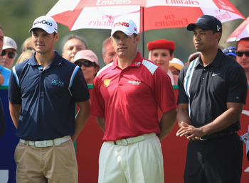 From left to right: Kaymer, Westwood, and Woods
