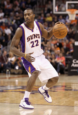 PHOENIX, AZ - JANUARY 30:  Zabian Dowdell #22 of the Phoenix Suns handles the ball during the NBA game against the New Orleans Hornets at US Airways Center on January 30, 2011 in Phoenix, Arizona.  The Suns defeated the Hornets 104-102. NOTE TO USER: User