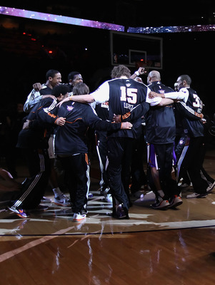 PHOENIX, AZ - FEBRUARY 13:  The Phoenix Suns huddle up on the court near Darth Vader and characters from 'Star Wars' before the NBA game against the Sacramento Kings at US Airways Center on February 13, 2011 in Phoenix, Arizona.  NOTE TO USER: User expres