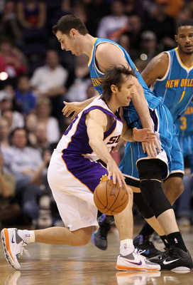 PHOENIX, AZ - JANUARY 30:  Steve Nash #13 of the Phoenix Suns handles the ball during the NBA game against the New Orleans Hornets at US Airways Center on January 30, 2011 in Phoenix, Arizona.  The Suns defeated the Hornets 104-102. NOTE TO USER: User exp