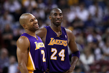 SACRAMENTO, CA - NOVEMBER 03:  Kobe Bryant #24 talks with Derek Fisher #2 of the Los Angeles Lakers during their game against the Sacramento Kings at ARCO Arena on November 3, 2010 in Sacramento, California.  NOTE TO USER: User expressly acknowledges and