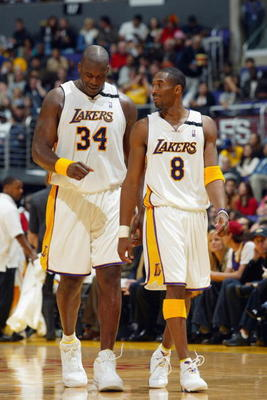 LOS ANGELES - DECEMBER 29:  Shaquille O'Neal #34 and Kobe Bryant #8 of the Los Angeles Lakers walk back on the court after a time out against the Toronto Raptors  during the game at Staples Center on December 29, 2002 in Los Angeles, California.  The Lake