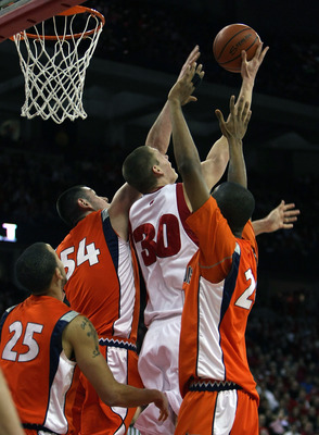 MADISON, WI - FEBRUARY 5: Jon Leuer #30 of the Wisconsin Badgers hits a shot with his back to the basket against Calvin Brock #25, Mike Tisdale #54 and Mike Davis #24 of the Illinois Fighting Illini at the Kohl Center February 5, 2009 in Madison, Wisconsi