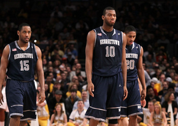 NEW YORK - MARCH 13: Austin Freeman #15, Greg Monroe #10 and Jerrelle Benimon #20 of the Georgetown Hoyas walk to the bench after a play against the West Virginia Mountaineers during the championship of the 2010 NCAA Big East Tournament at Madison Square