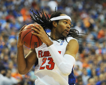GAINESVILLE, FL - NOVEMBER 16: Forward Alex Tyus #23  of the Florida Gators grabs a rebound against the Ohio State Buckeyes November 16, 2010 at the Stephen C. O'Connell Center in Gainesville, Florida.  (Photo by Al Messerschmidt/Getty Images)
