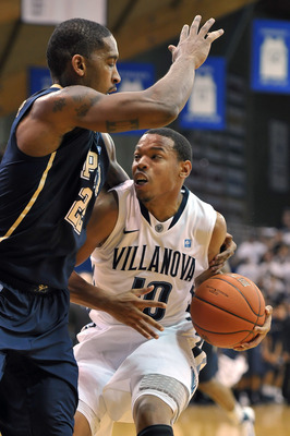 VILLANOVA, PA - FEBRUARY 12: Corey Fisher #10 of the Villanova Wildcats gets held by Brad Wanamaker #22 of the Pittsburgh Panthers at The Pavilion on February 12, 2011 in Villanova, Pennsylvania. Pittsburgh won 57-54.  (Photo by Drew Hallowell/Getty Image