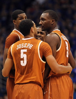 LAWRENCE, KS - JANUARY 22: Texas Longhorns players huddle during the game against the Kansas Jayhawks on January 22, 2011 at Allen Fieldhouse in Lawrence, Kansas.  (Photo by Jamie Squire/Getty Images)