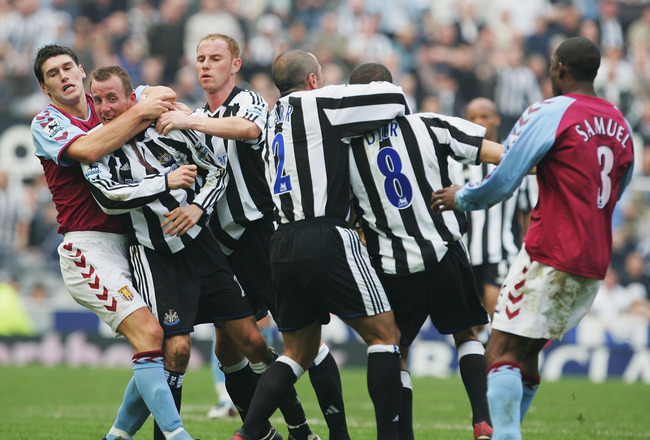 NEWCASTLE, ENGLAND - APRIL 2 :  Gareth Barry of Aston Villa pulls apart the fighting Lee Bowyer and Kieron Dyer of Newcastle during the FA Barclays Premiership match between Newcastle United and Aston Villa at St James Park on April 2, 2005 in Newcastle,