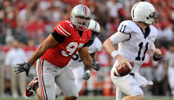COLUMBUS, OH - NOVEMBER 13:  Cameron Heyward #97 of the Ohio State Buckeyes chases after quarterback Matt McGloin #11 of the Penn State Nittany Lions at Ohio Stadium on November 13, 2010 in Columbus, Ohio.  (Photo by Jamie Sabau/Getty Images)