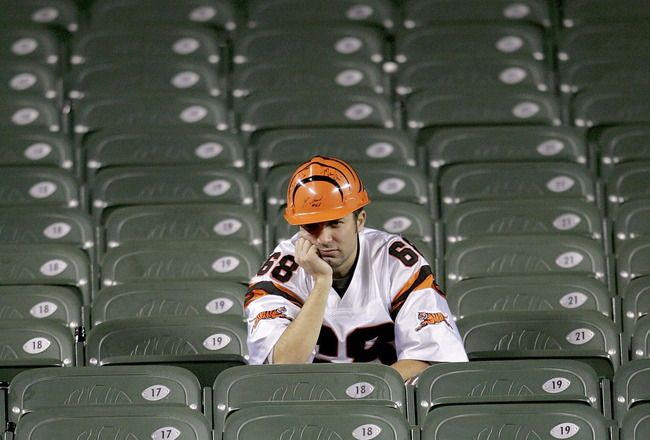 CINCINNATI - JANUARY 8:  A fan of the Cincinnati Bengals sits dejected in the stands after the Bengals lost the AFC Wild Card Playoff Game to the Pittsburgh Steelers at Paul Brown Stadium on January 8, 2006 in Cincinnati, Ohio. The Steelers won 31-17 and